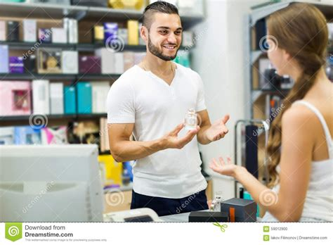 Client At Shop Paying At Cash Register Desk Stock Photo