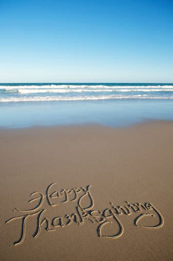 Happy Thanksgiving Message On Smooth Beach Stock Photo